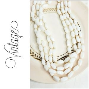 Vintage 1920s long milk glass beaded necklace